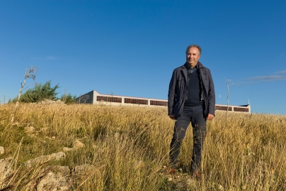 Michele D'Alonzo, owner of Elfim srl. Background: Elfim srl on the Murgia Hill.